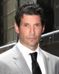 A. Vince Colella