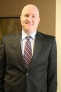 Christopher M. Locey